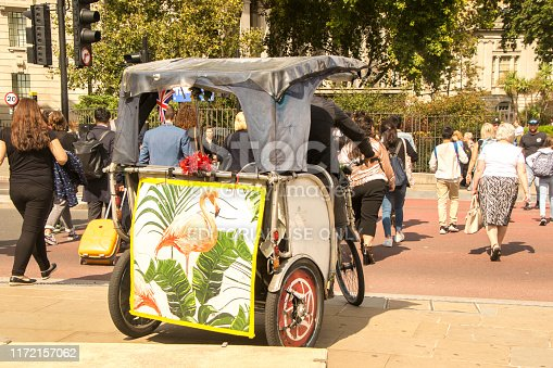 August 20, 2019 – Tower Hill, London, United Kingdom. A typical method of transport found in London, England, a Tuk Tuk. These Tuk Tuks take people, mainly tourists, around the city of London and often are seen as a problem to other transportation.