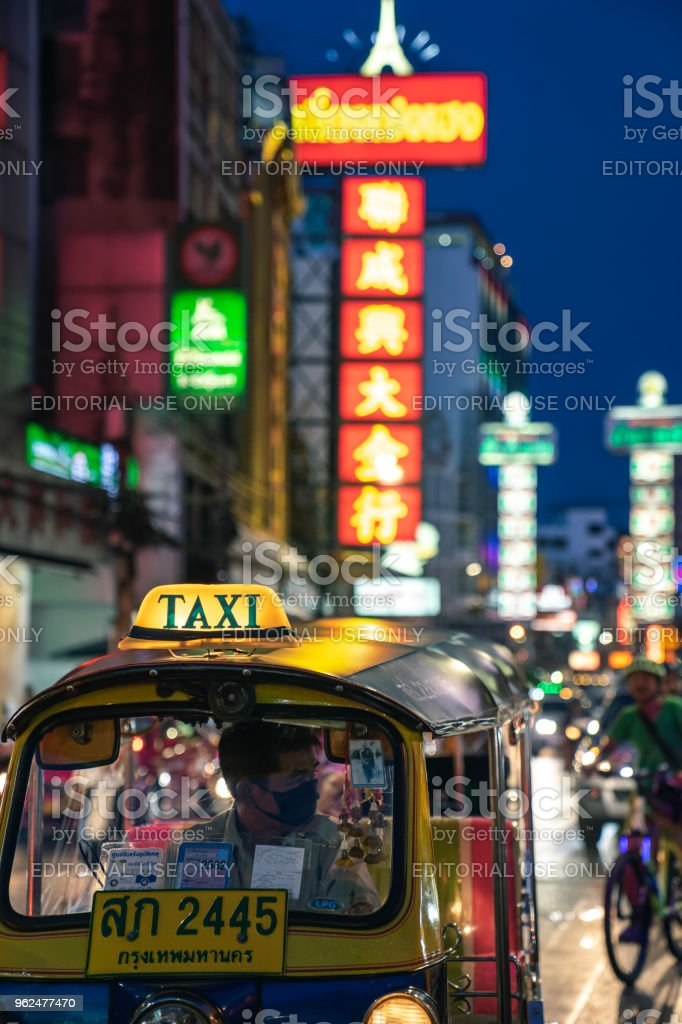 Tuk tuk taxi parked in street market in the main street of Chinatown,...