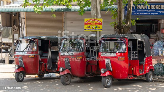 Three tuktuks on the street of Negombo.