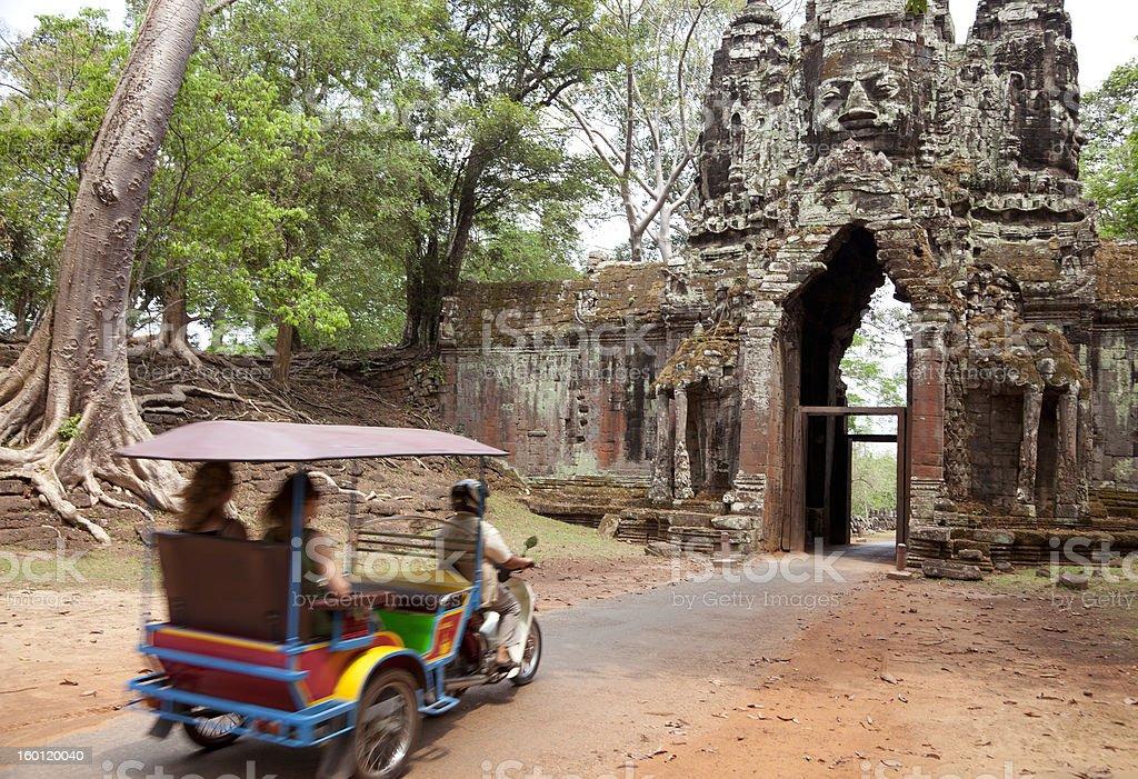 tuktuk touring at Angkor Thom, Cambodia royalty-free stock photo