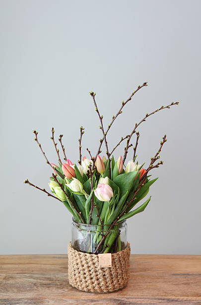 Tulip Bouquet In Homemade Jute Crochet Vase stock photo