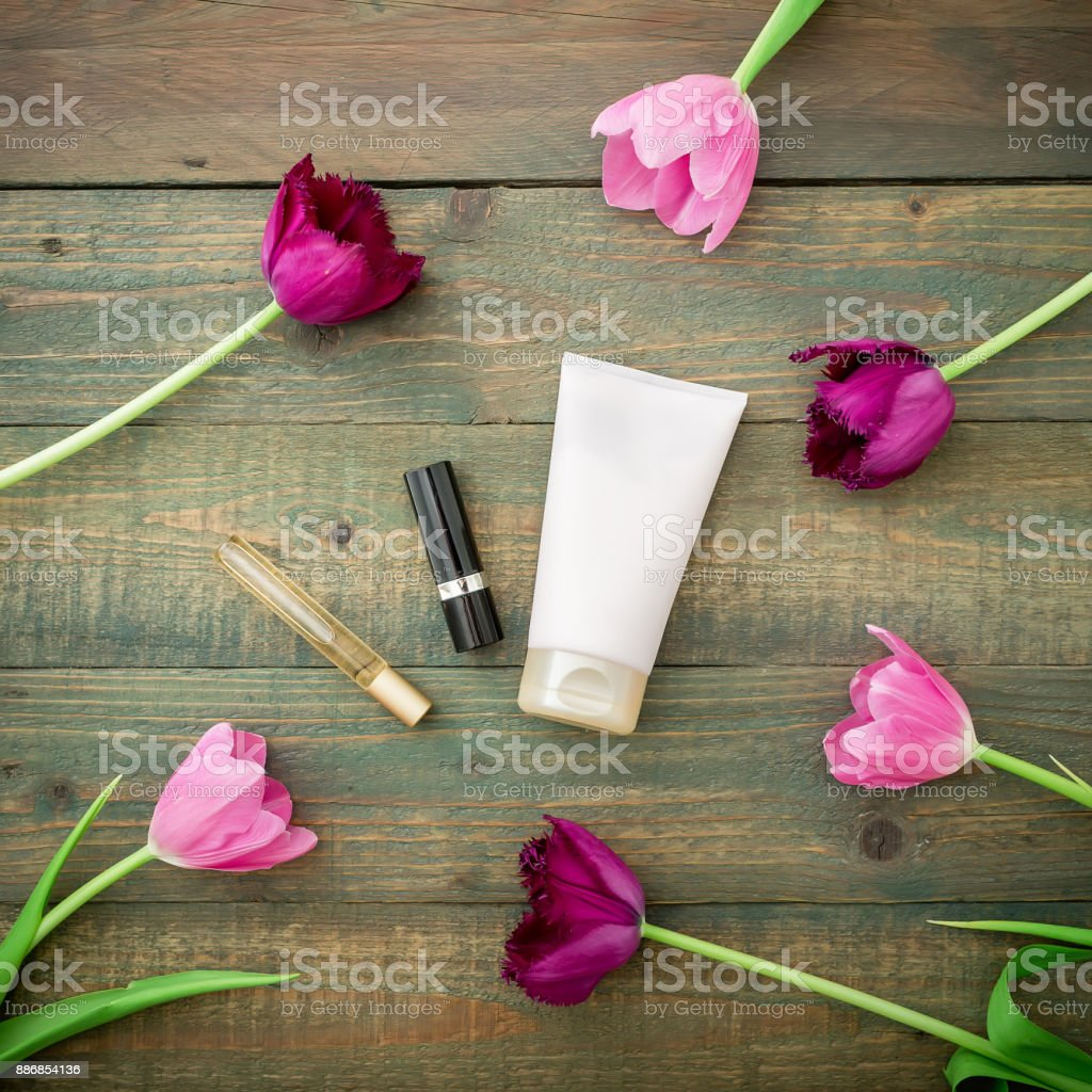 Tulip flowers and women's accessories. Flat lay, Top view stock photo