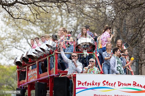 Holland, Michigan, USA - May 11, 2019: Tulip Time Parade, Members of the Petoskey Steel Drum Band, performing during the parade