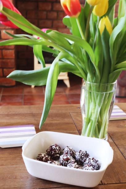 Tulips and chocolates stock photo