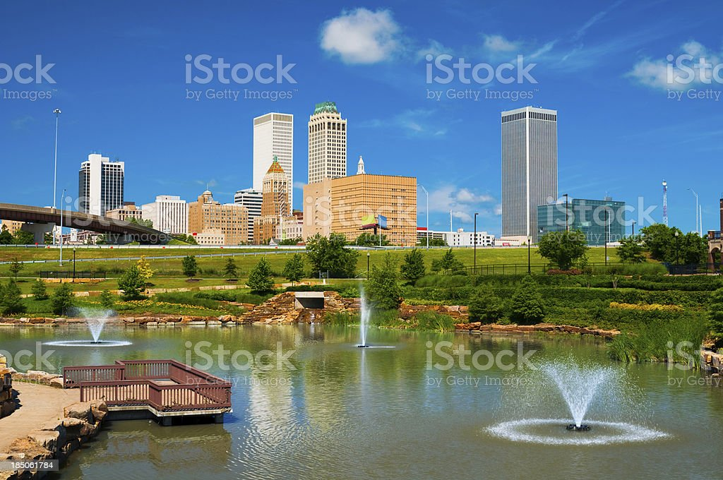 Tulsa skyline, pond, and fountains stock photo