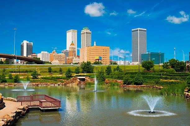 Tulsa skyline, pond, and fountains stock photo