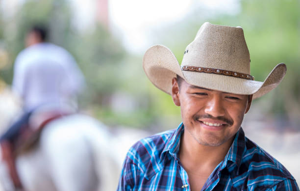 Tulum, Mexico, March 14th, 2017: cowboy at a ranch Tulum, Mexico, March 14th, 2017: cowboy at a ranch rancher stock pictures, royalty-free photos & images