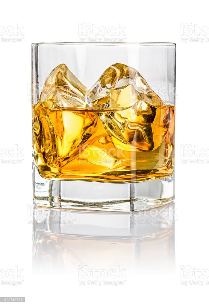 Tumbler with whiskey on the rocks stock photo