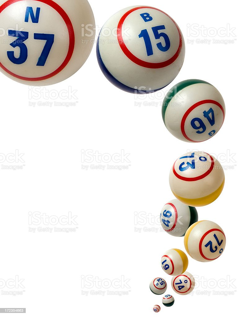 Tumbling bingo balls with various numbers on royalty-free stock photo