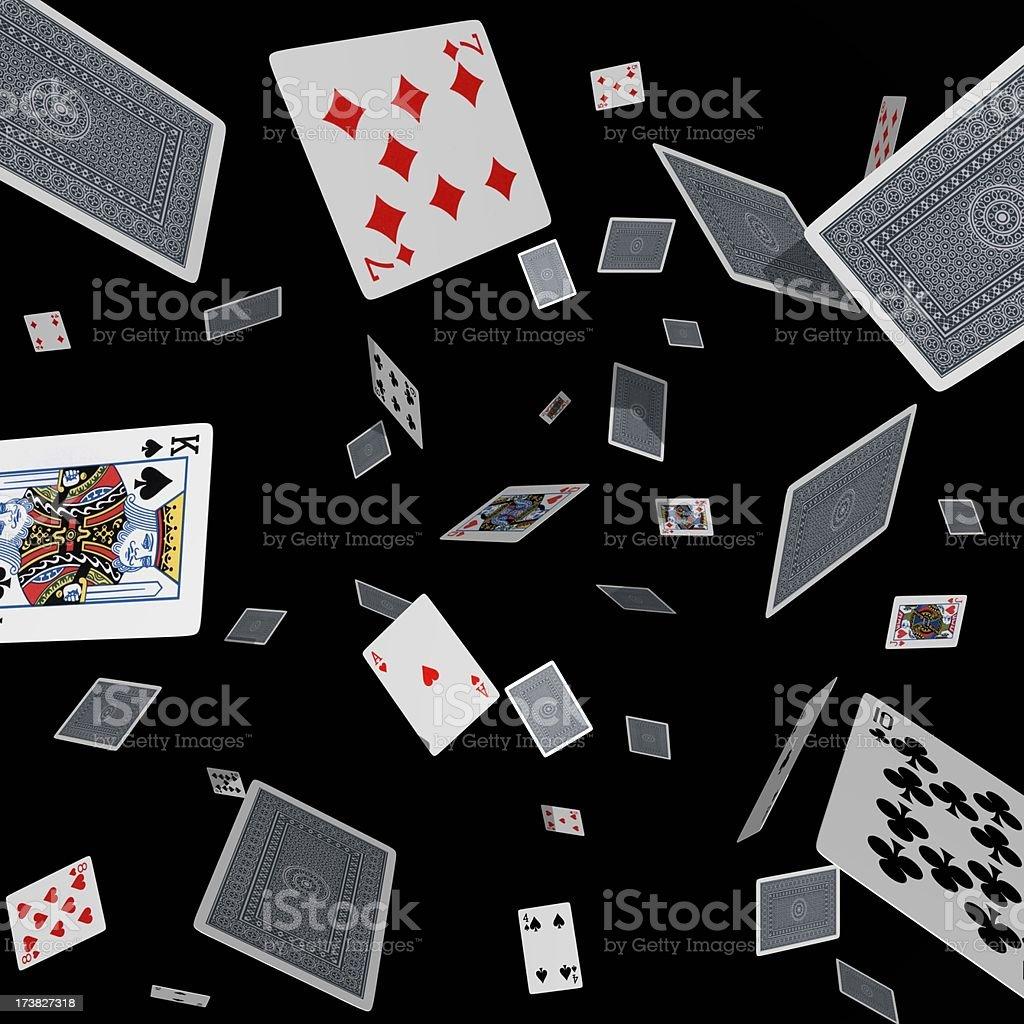 Tumbling cards on black stock photo