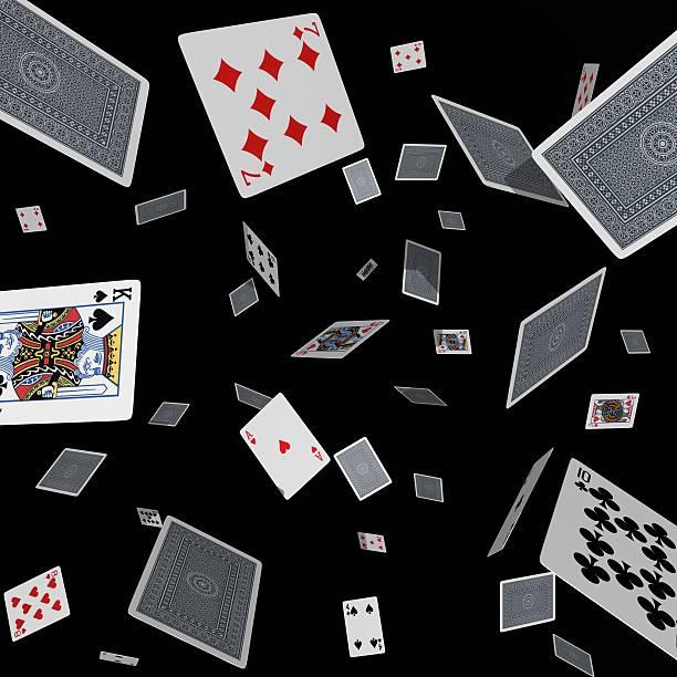 Tumbling cards on black