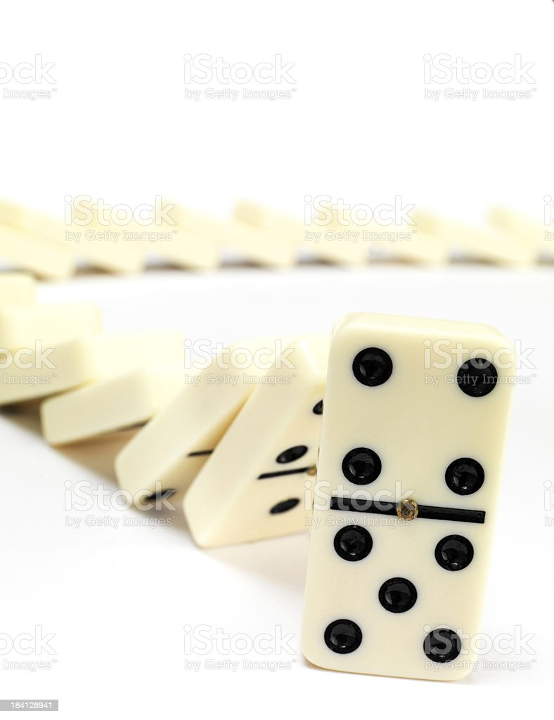 tumbling dominos in a line royalty-free stock photo