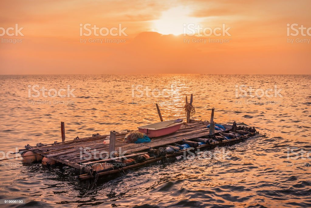 Tumbling in the sea in the evening, lonely concept stock photo