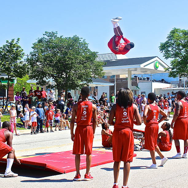 Tumbling team performs at Independence Day 4th of July Parade stock photo