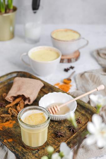 Tumeric Golden Milk Chai Latte Kurkuma Tea with Milk in spring
