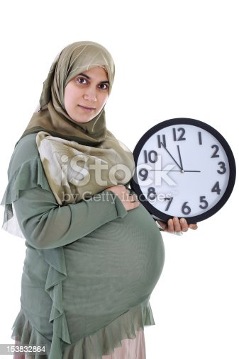 istock Tummy of pregnant muslim woman with clock 153832864