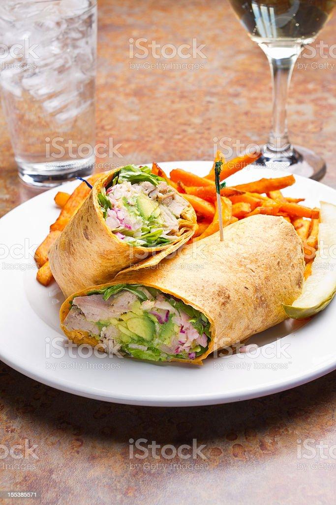 Tuna Avocado Wrap with Sweet Potato Fries stock photo