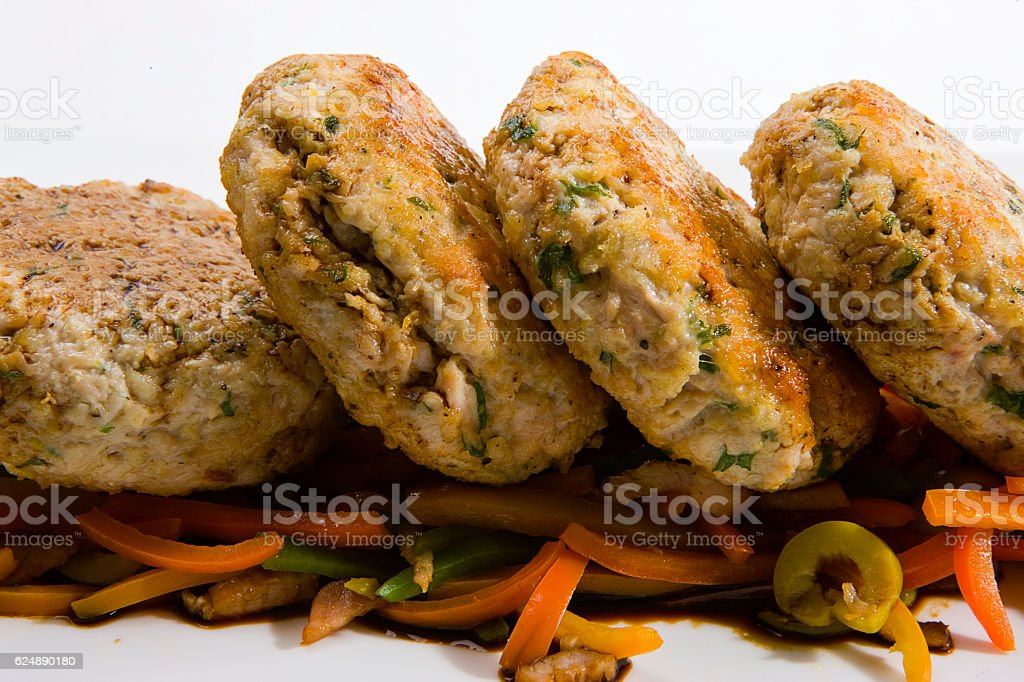 Tuna burgers with vegetable bed stock photo