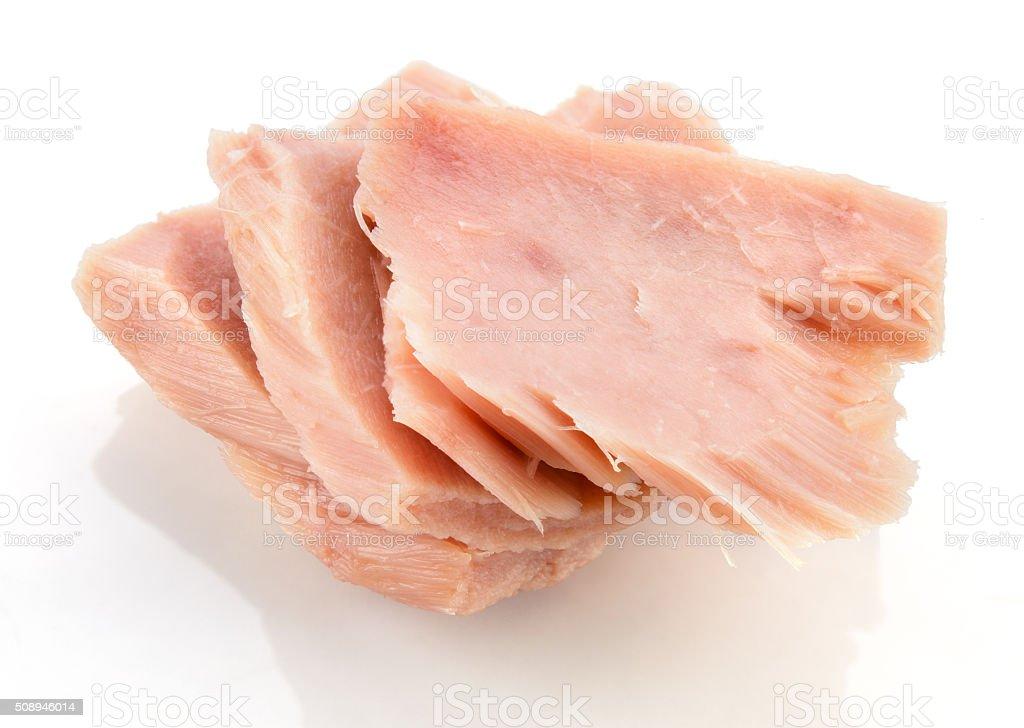 Tuna. Canned fish isolated on white. Macro. stock photo