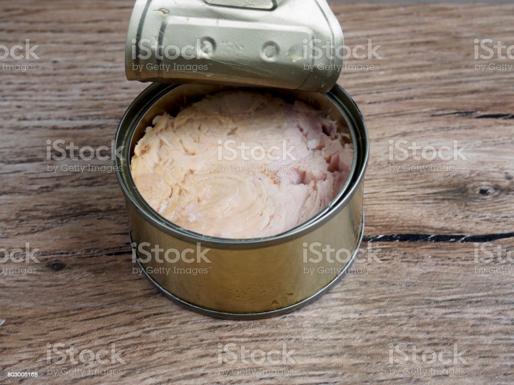 Tuna canned on wood background stock photo