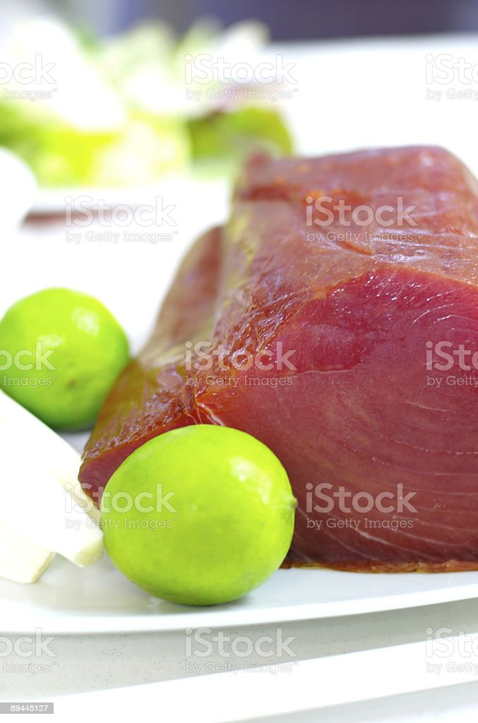 tuna fish and a lemon royalty-free stock photo