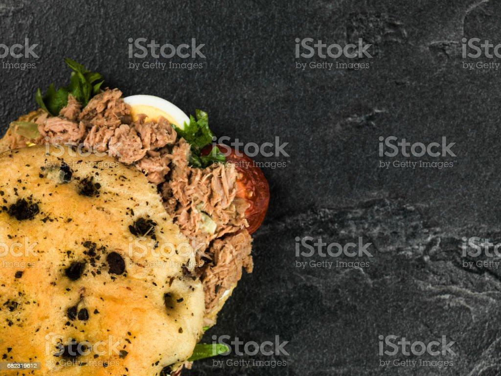 Tuna Nicoise Salad In a Focaccia Bread Bun stock photo