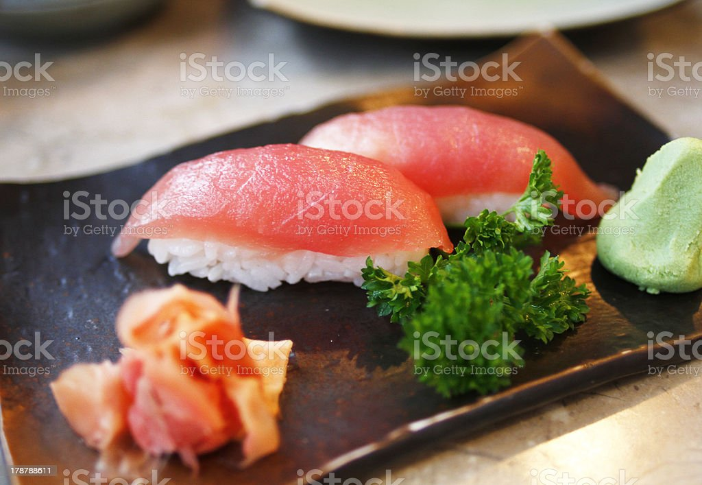 Tuna rolls sushi on a traditional plate royalty-free stock photo