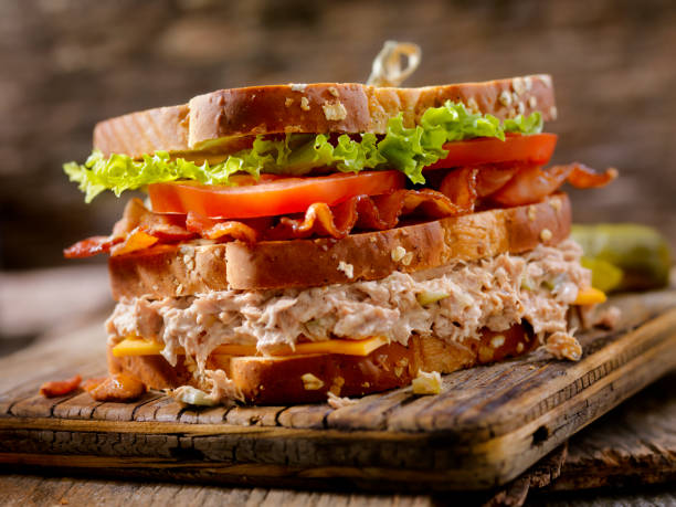 Tuna Salad, BLT, Clubhouse Sandwich Creamy Tuna Salad, BLT, Clubhouse Sandwich on Toasted Whole Grain Bread tuna seafood stock pictures, royalty-free photos & images