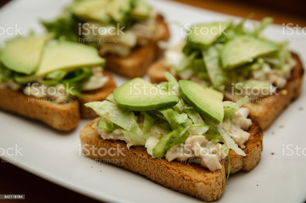 Tuna salad sandwich with avocado stock photo