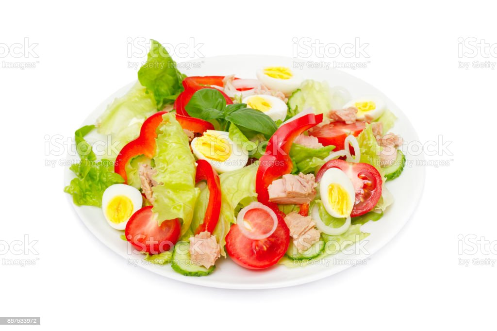 Tuna salad with lettuce, eggs and tomatoes. stock photo