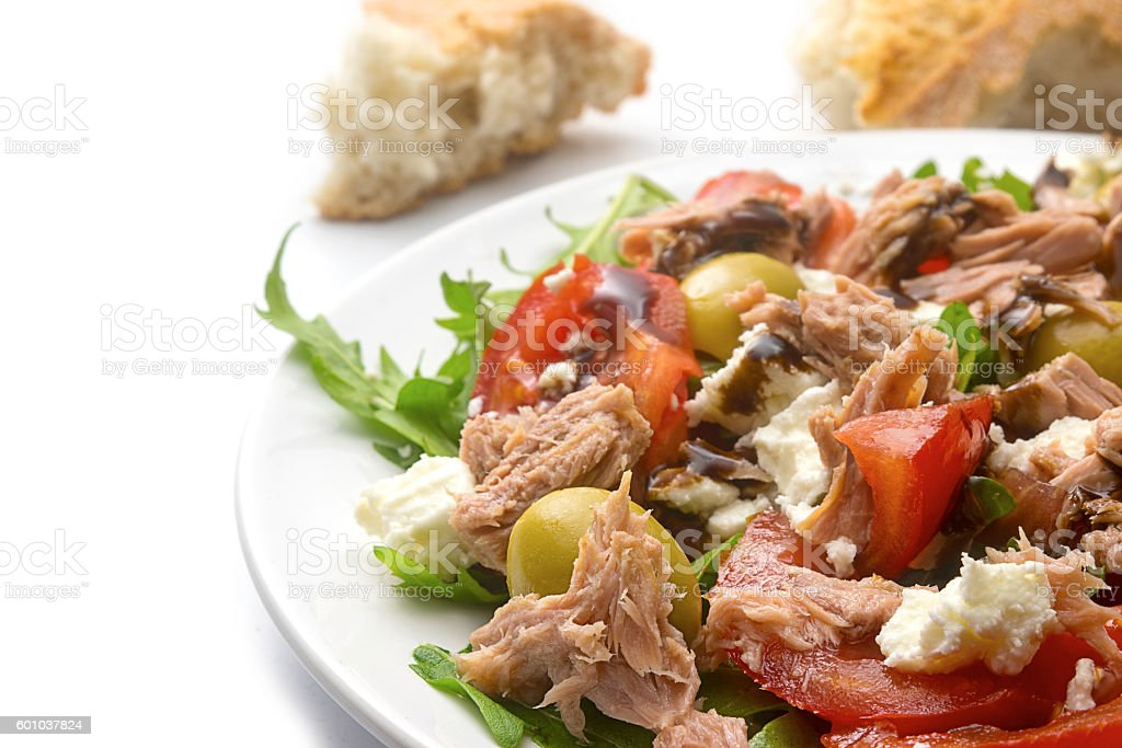 tuna salad with tomatoes, olives and rukkola, Mediterranean recipe stock photo