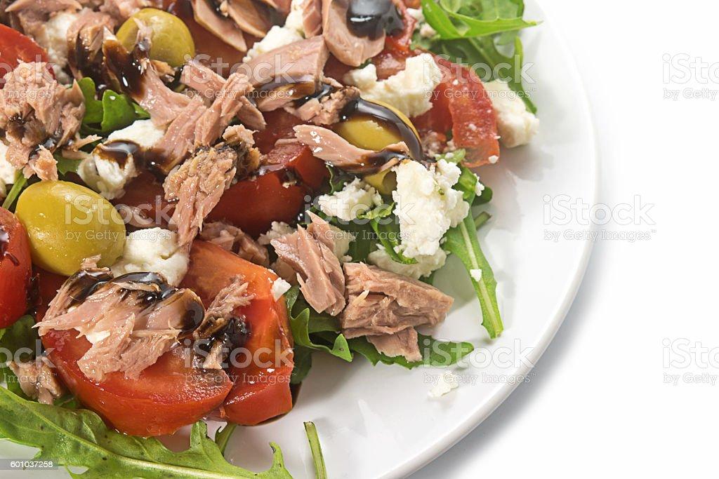 tuna salad with tomatoes, olives and rukkola, recipe, close up stock photo