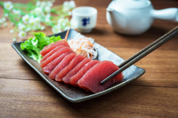 Tuna sashimi, raw fish in traditional Japanese style Tuna sashimi, raw fish in traditional Japanese style tuna animal stock pictures, royalty-free photos & images