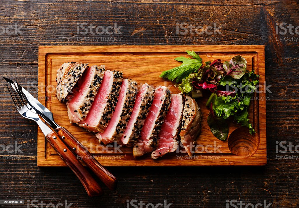 Tuna steak and Green salad stock photo