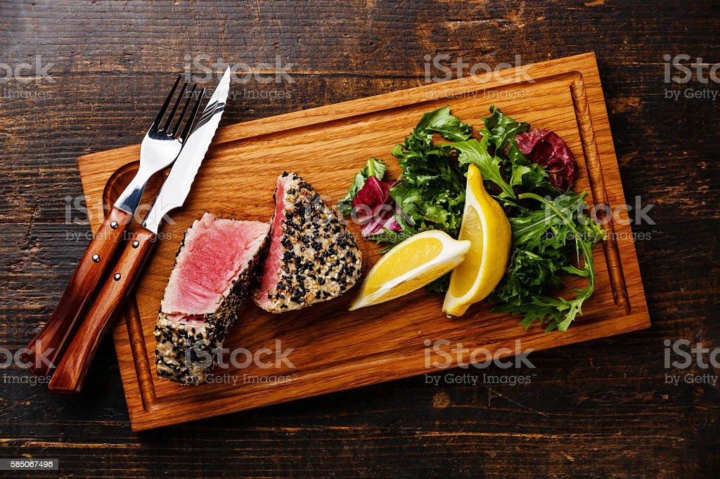 Tuna steak in sesame and lemon stock photo