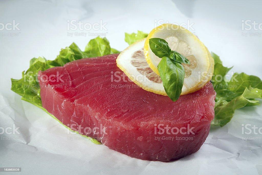 Tuna steak on paper royalty-free stock photo