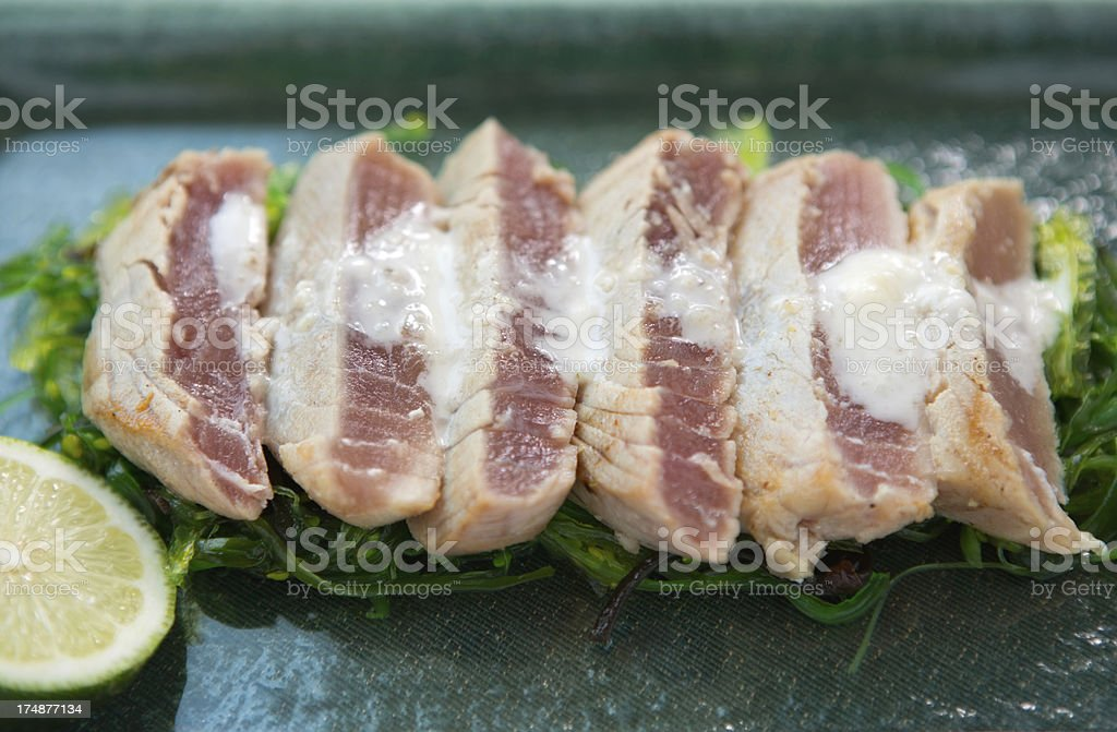 Tuna steak on wakame. royalty-free stock photo