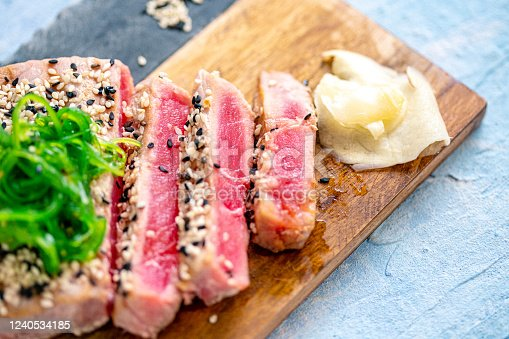 Raw Tuna Steak with ingredients ready to eat