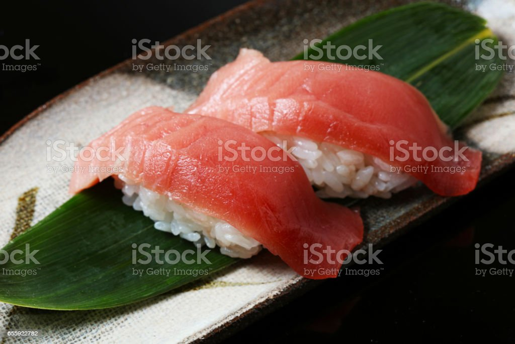 tuna sushi set on black background stock photo