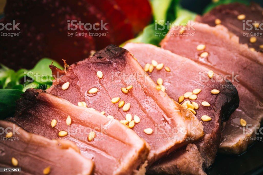 Tuna tataki detail with sesame sauce and strawberry stock photo