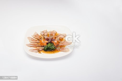 Tuna tatami served with white plant front of white background
