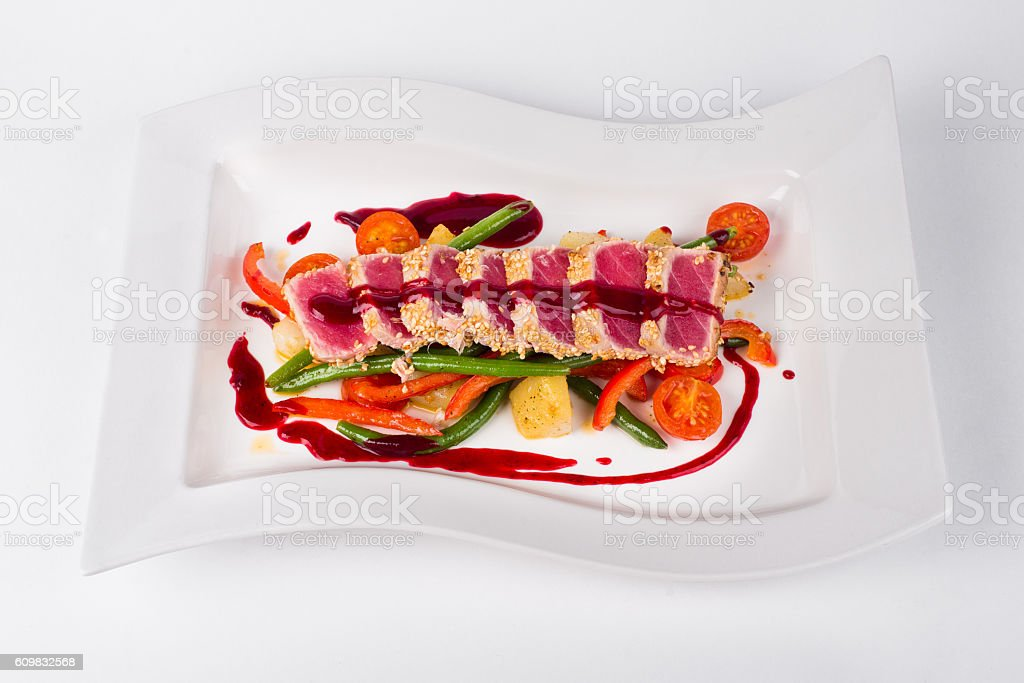 Tuna with berry sauce, vegetables, tomatoes, green bean and chil stock photo
