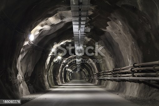 istock Tunel incline with concrete road 185092276