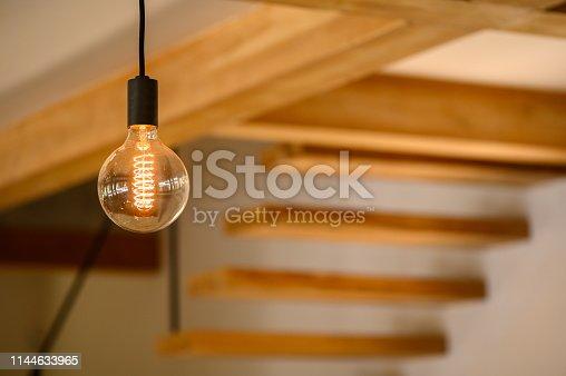 Tungsten light bulb in a modern home interior