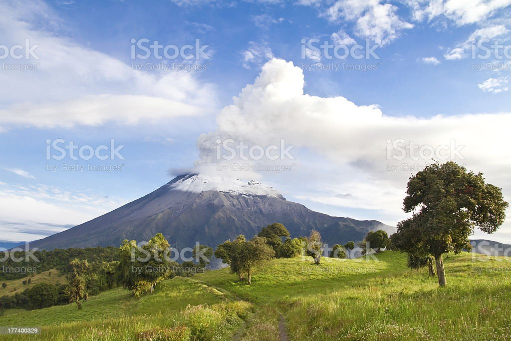 Tungurahua Volcano erupting at sunrise with smoke stock photo