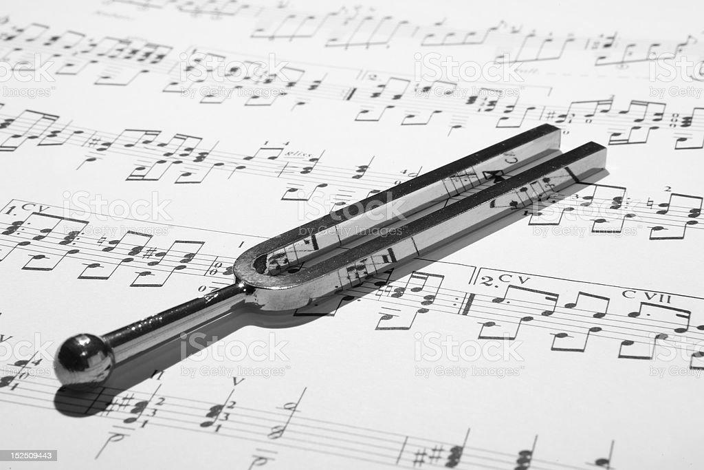 Tuning Fork on Sheet Music stock photo
