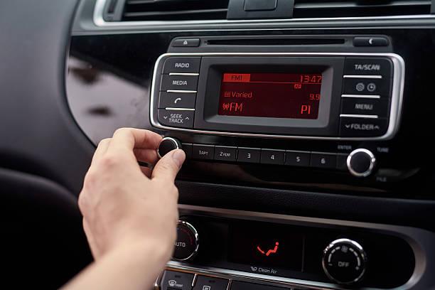 tuning the stereo - radio foto e immagini stock