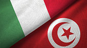 Tunisia and Italy two flags together textile cloth fabric texture