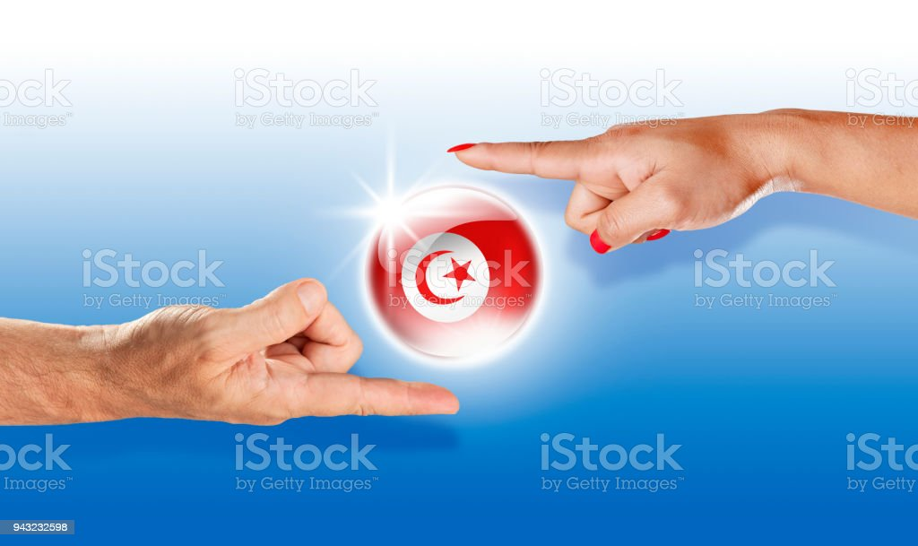 Tunisia button tunisian flag floating between human hands stock photo