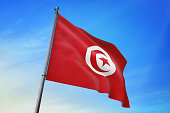 Tunisia flag waving in the blue sky